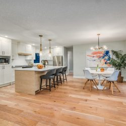 Interior of a home open concept kitchen and dining room with light wood floors - Kay2 Contracting