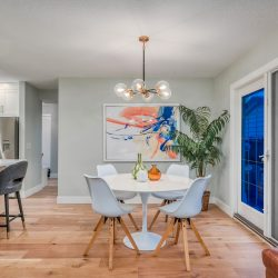 Open concept kitchen and dining room with circle table and sliding glass doors - Kay2 Contracting