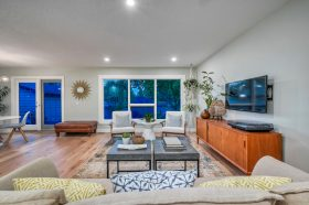 Remodeled living room with wood floors and windows to exterior - Kay2 Contracting