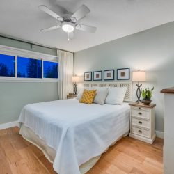 Updated master bedroom with wood floors and windows - Kay2 Contracting