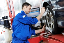 Image of mechanic working on vehicle rims