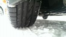 Image of tires moving through snow
