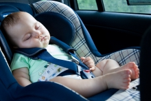 Image of baby sleeping in vehicle