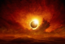 Image of an eclipse with red sky