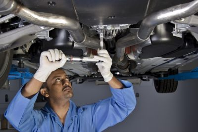 Image of mechanic working on the underside of a vehicle