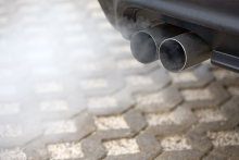 Image of exhaust pipes working on a car