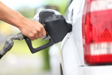 Image of someone filling up a car with gas