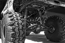Image of large tires and a suspended truck