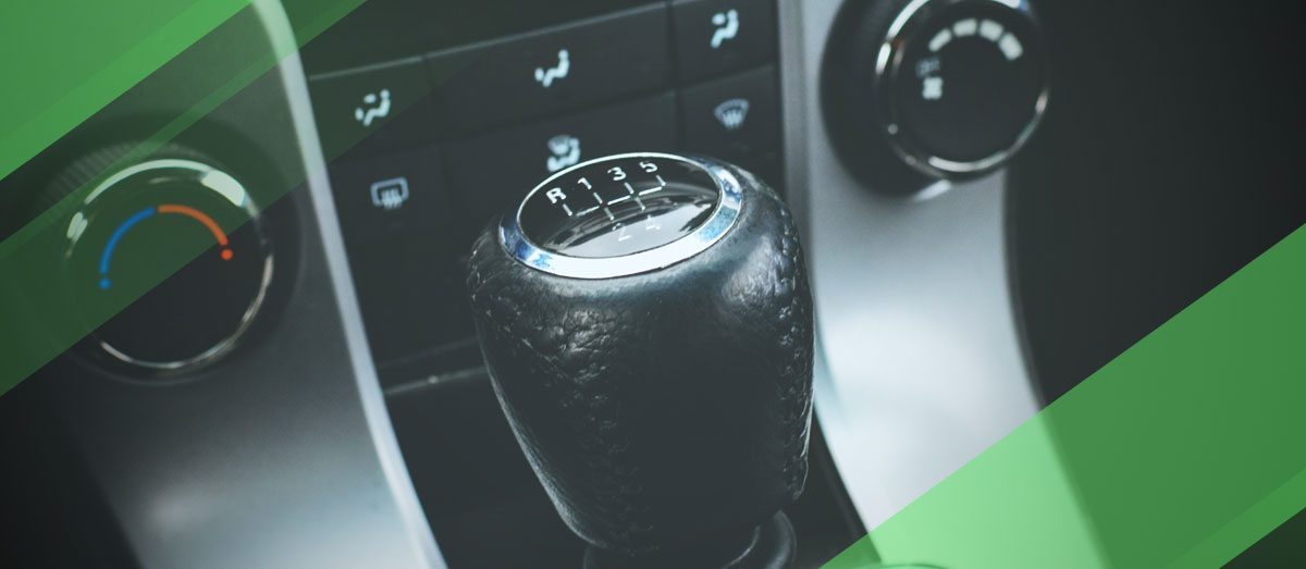 Zoomed in image of manual stick shifter with green edits