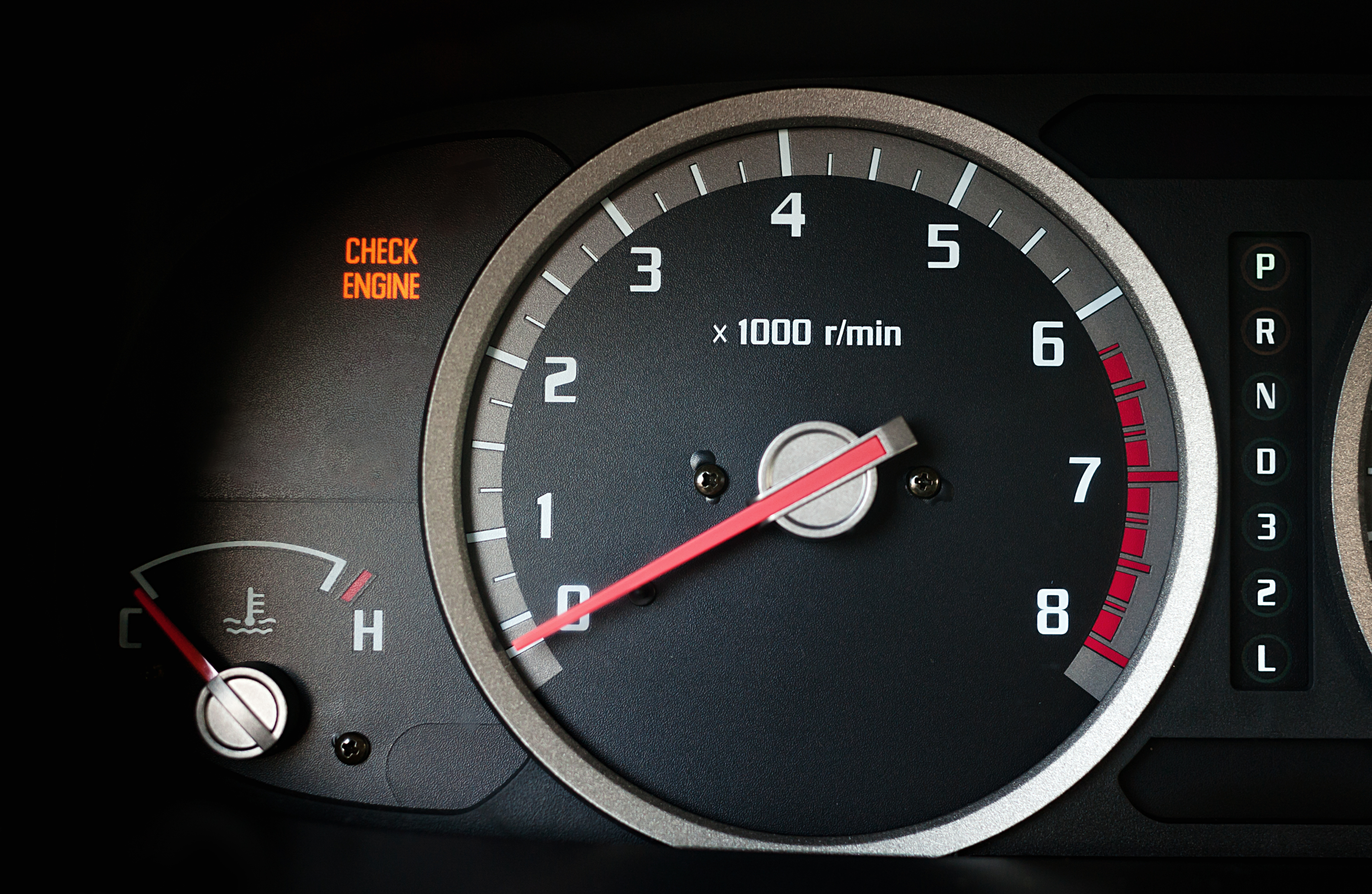 Image of Check Engine Light Alongside Spedometer