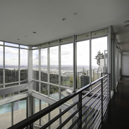 Photo of a landing with view of a wall of windows in a Los Angeles house - Keeprshots
