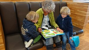 grandmother reading with her grand kids