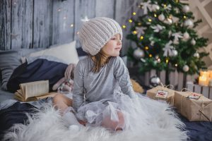 little girl with wrapped presents