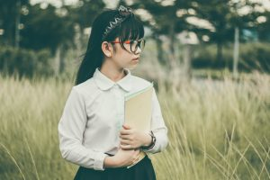 girl wearing reading glasses