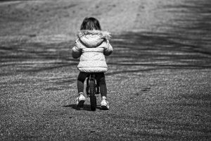 preschool girl riding a bicycle