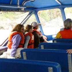several people in life jackets on the jet boat in Idaho