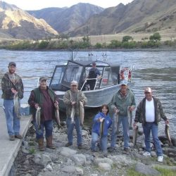 group fishing with hells canyon in the background