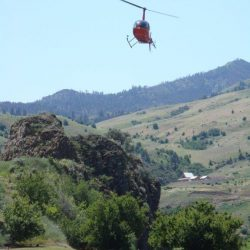 a helicopter over hells canyon