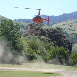 a helicopter landing in Hells Canyon
