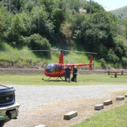 People looking at a Helicopter at Killgore Adventures