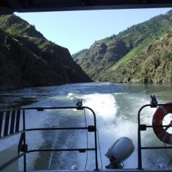 Hells canyon back of the jet boat with life preserver