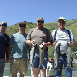 Four men and the fish they caught