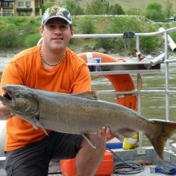 a man holding a large salmon