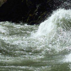 a wave of crashing water