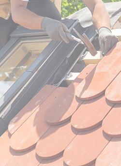 Image of man repairing roof