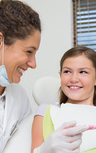 dentist smiling with child