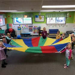 Our Rosemount daycare program playing with a multicolor parachute