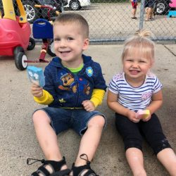 A picture of two preschoolers sitting together - Leaps and Bounds