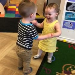 A picture of two preschoolers playing together - Leaps and Bounds