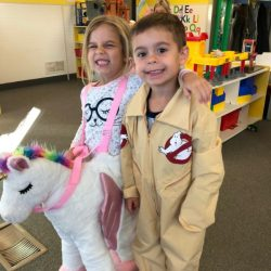 A picture of two pre-kindergarten children in costume - Leaps and Bounds