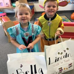 A picture of two preschoolers in costume - Leaps and Bounds