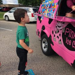 A picture of a preschooler getting ice cream - Leaps and Bounds