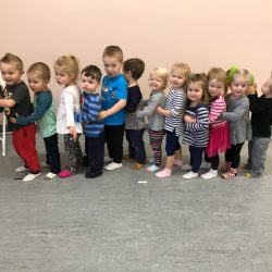 A picture of two a group of preschoolers in a line - Leaps and Bounds
