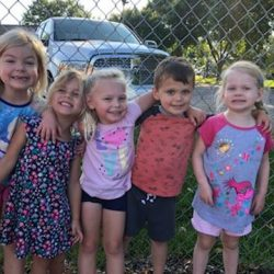A picture of a group of pre-kindergarten children standing together - Leaps and Bounds