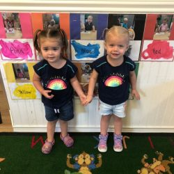 A picture of two preschoolers holding hands - Leaps and Bounds