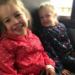 A picture of two pre-kindergarten children riding in a bus - Leaps and Bounds