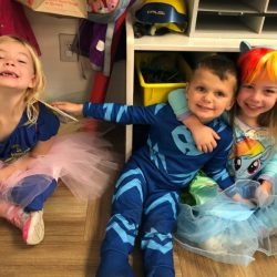 A picture of three pre-kindergarten children sitting together - Leaps and Bounds