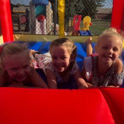 A picture of three pre-kindergarten children playing together - Leaps and Bounds