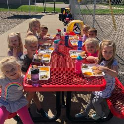 A picture of a group of pre-kindergarten children eating together - Leaps and Bounds
