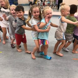 A picture of a group of pre-kindergarten children standing in line together - Leaps and Bounds
