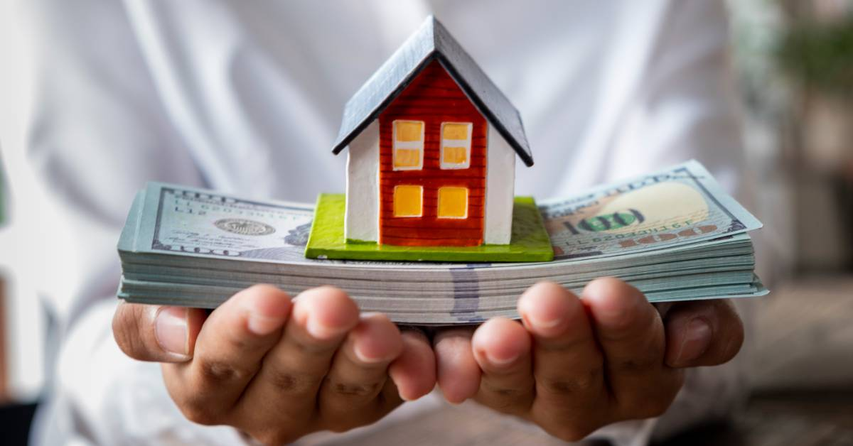 An image of a homeowner with cash.