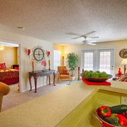 Apartment open concept kitchen and living room with natural light - The Legends Apartments