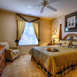 Large apartment bedroom with window - The Legends Apartments
