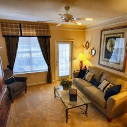 Large apartment living room with door to patio - The Legends Apartments