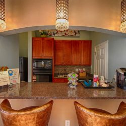 Breakfast bar and kitchen at our club house - The Legends Apartments