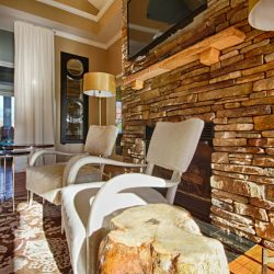 Fireplace and cozy living room space at our club house - The Legends Apartments